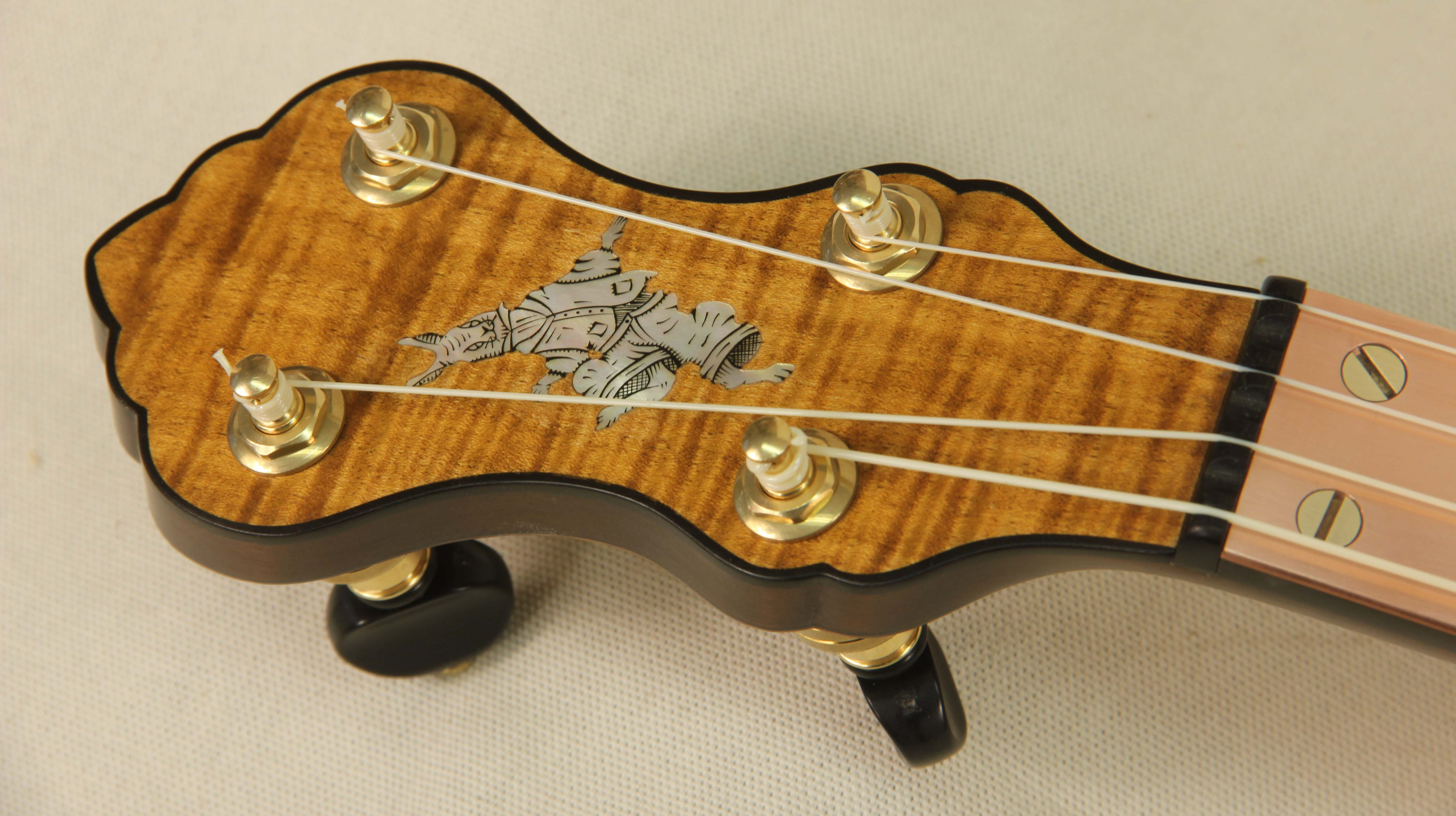 Engraved mother of pearl B'rer Rabbit inlay with ebony peghead binding