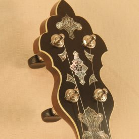 custom banjo peghead with engraved mother of pearl