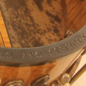 Custom banjo rim engraving